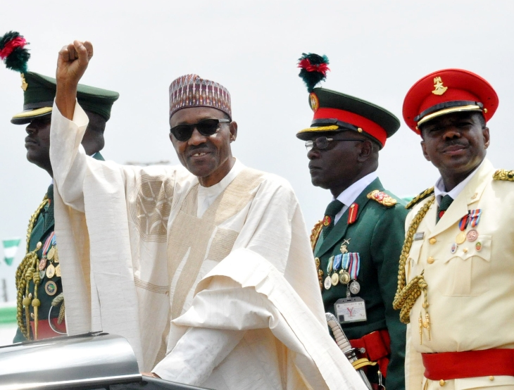 PIC.6. PRESIDENT MUHAMMADU BUHARI ACKNOWLEDGING CHEERS DURING HIS INAUGURATION IN ABUJA ON FTIDAY(29/5/15). 2819/29/5/2015/CH/NAN